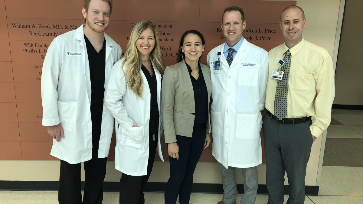 A group of doctors with Rep. Davids